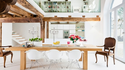 Open-plan interior with wood-beamed ceiling, mezzanine, kitchen & dining area